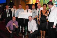 Sinead & Sean O'Hagan and Fergal Higgins presented with cheque from BCSC